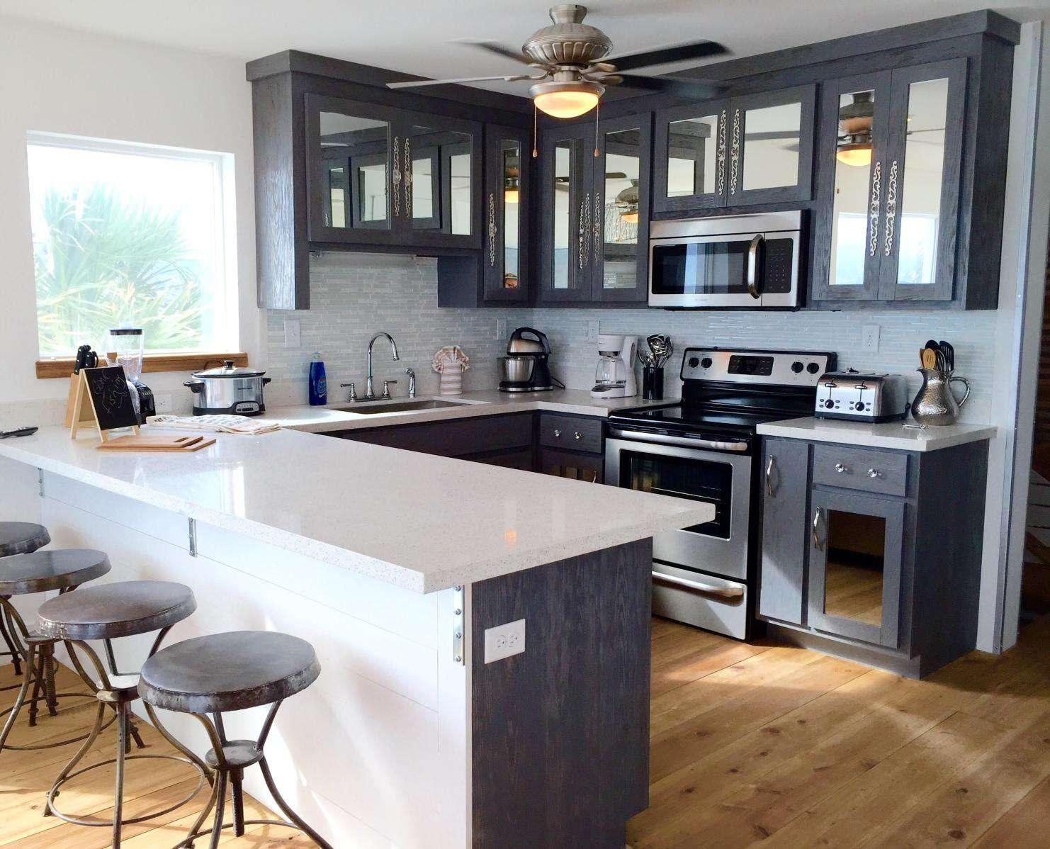 large kitchen , white quartz, 2 side by side refrigerators