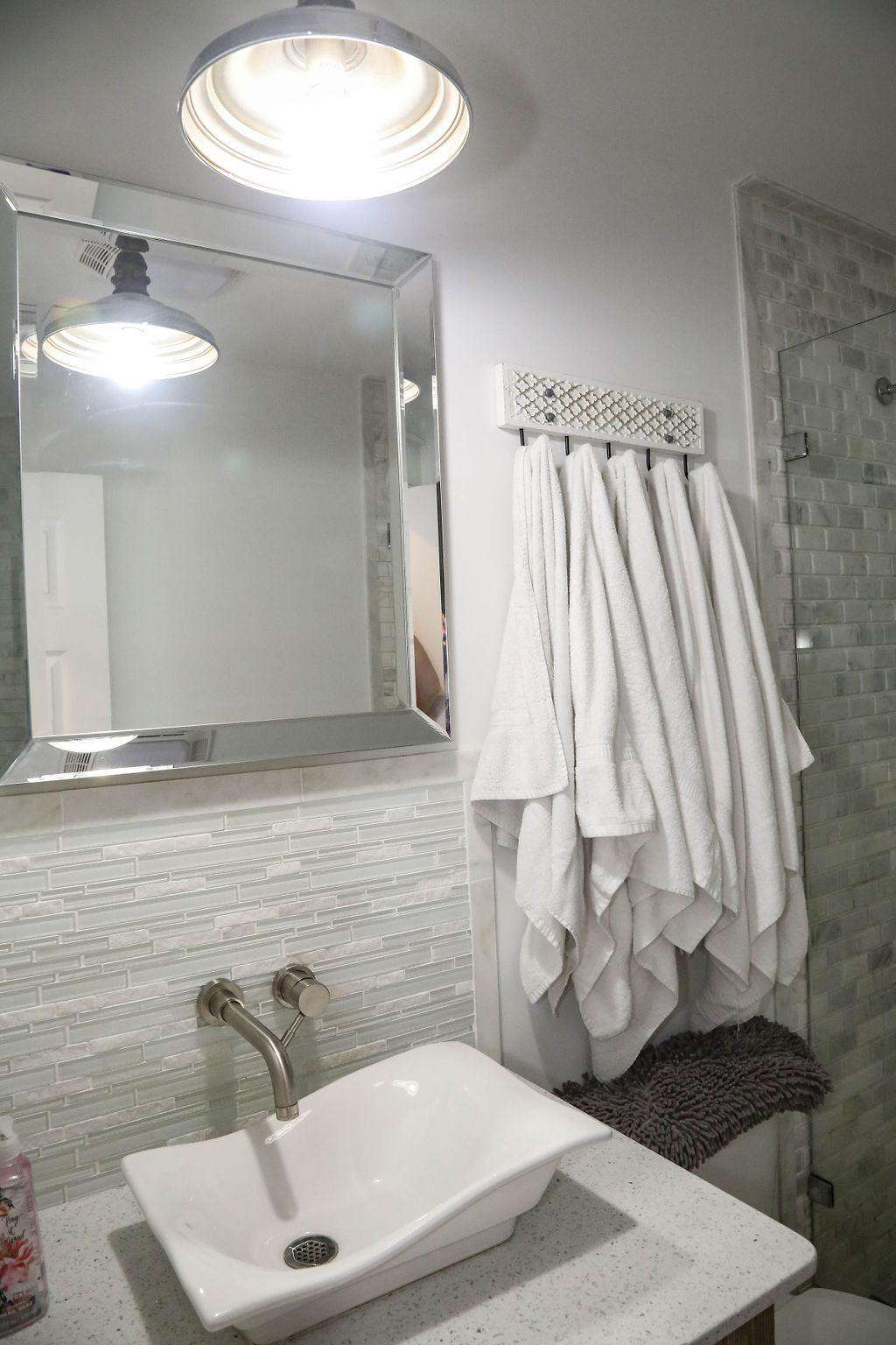 one of nine bathrooms in the home--white marble showers