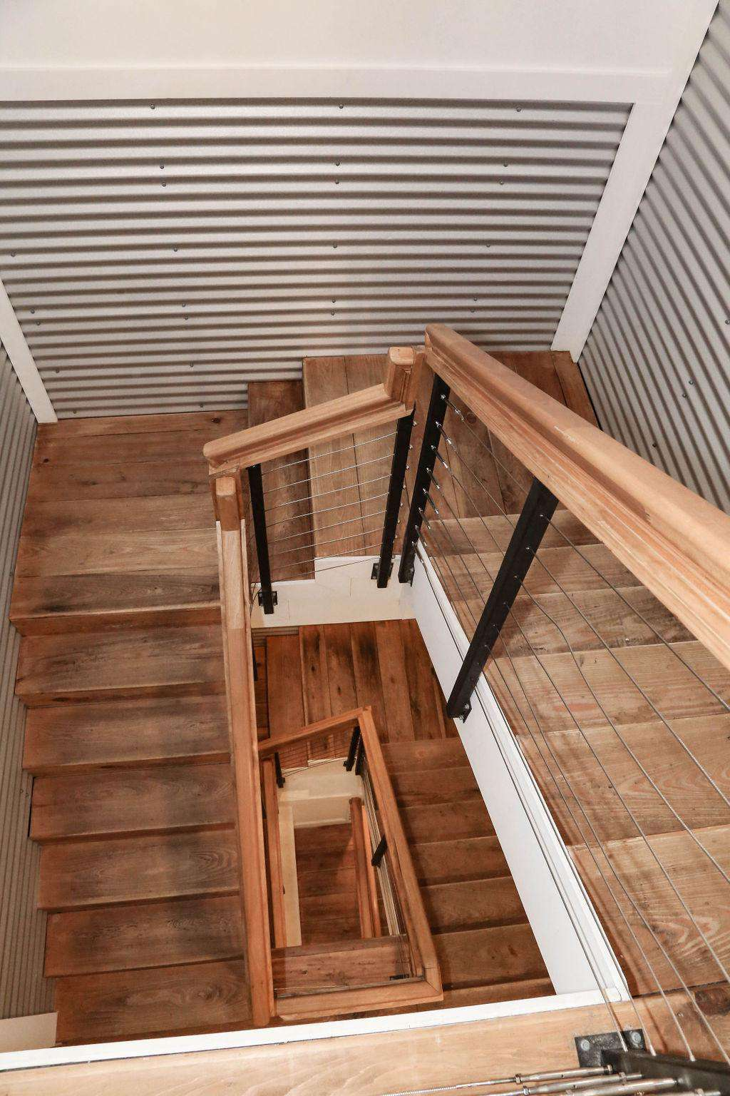 Stainless steel stairwell with hand rubbed cypress flooring