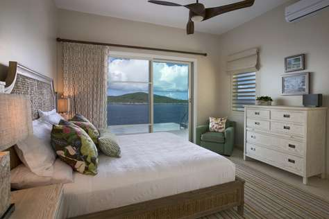 Guest Bedroom w/king bed and pool deck walkout
