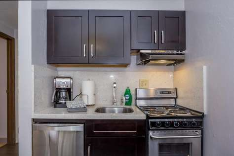 Your fully equipped kitchen with stove top oven, dishwasher, mircrowave, toaster & coffee maker.