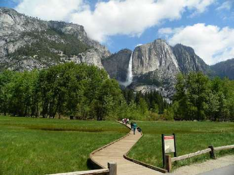 Walkway through the meadow in front of Yosemite Falls.