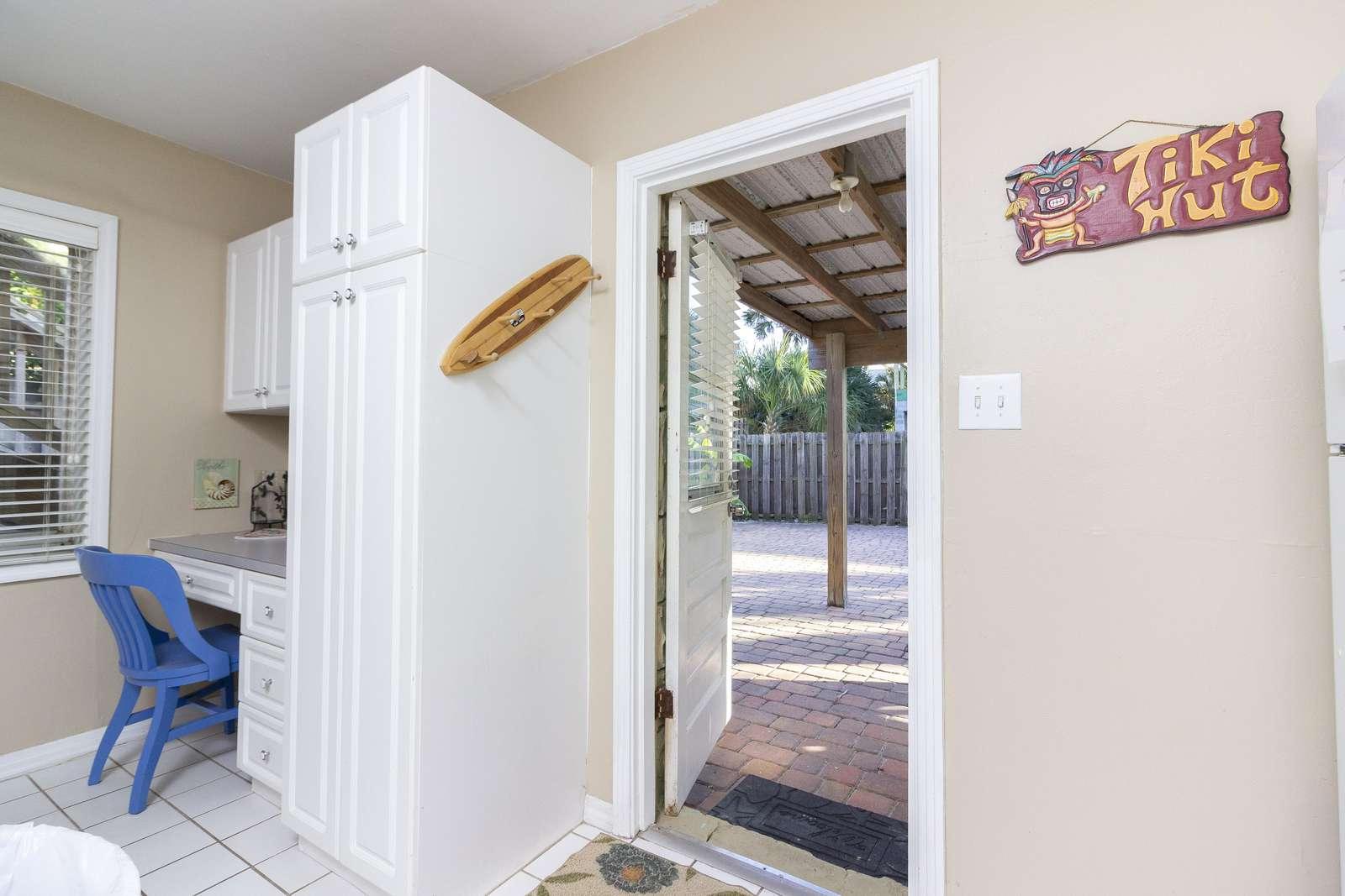 Desk / Back Door leading to spacious Backyard!