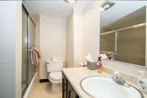 Your bathroom with vanity, shower/tub and toilet.