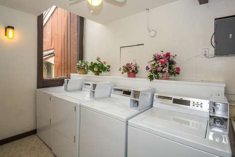 The laundry room upstairs in the building with coin operated machines.  Detergent is complimentary.