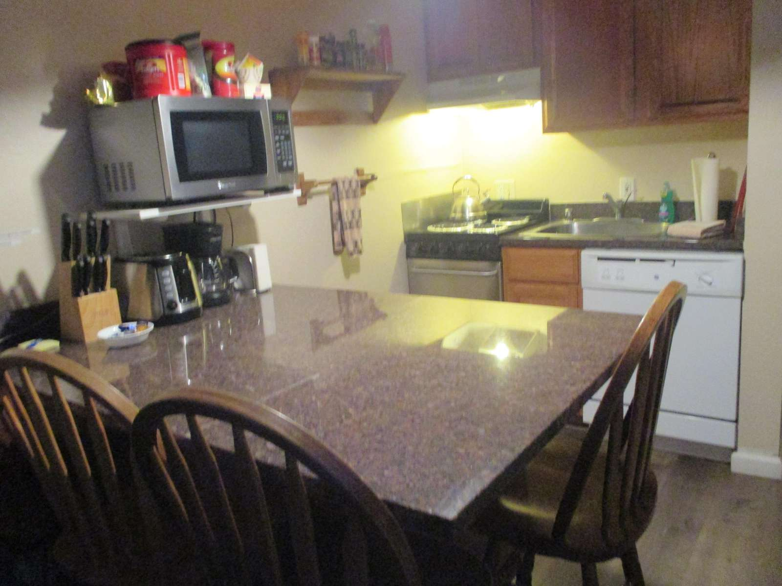 Kitchen is fully equipped with stove-top oven, dishwasher, microwave, dishes, cooking utensils and pots & pans.