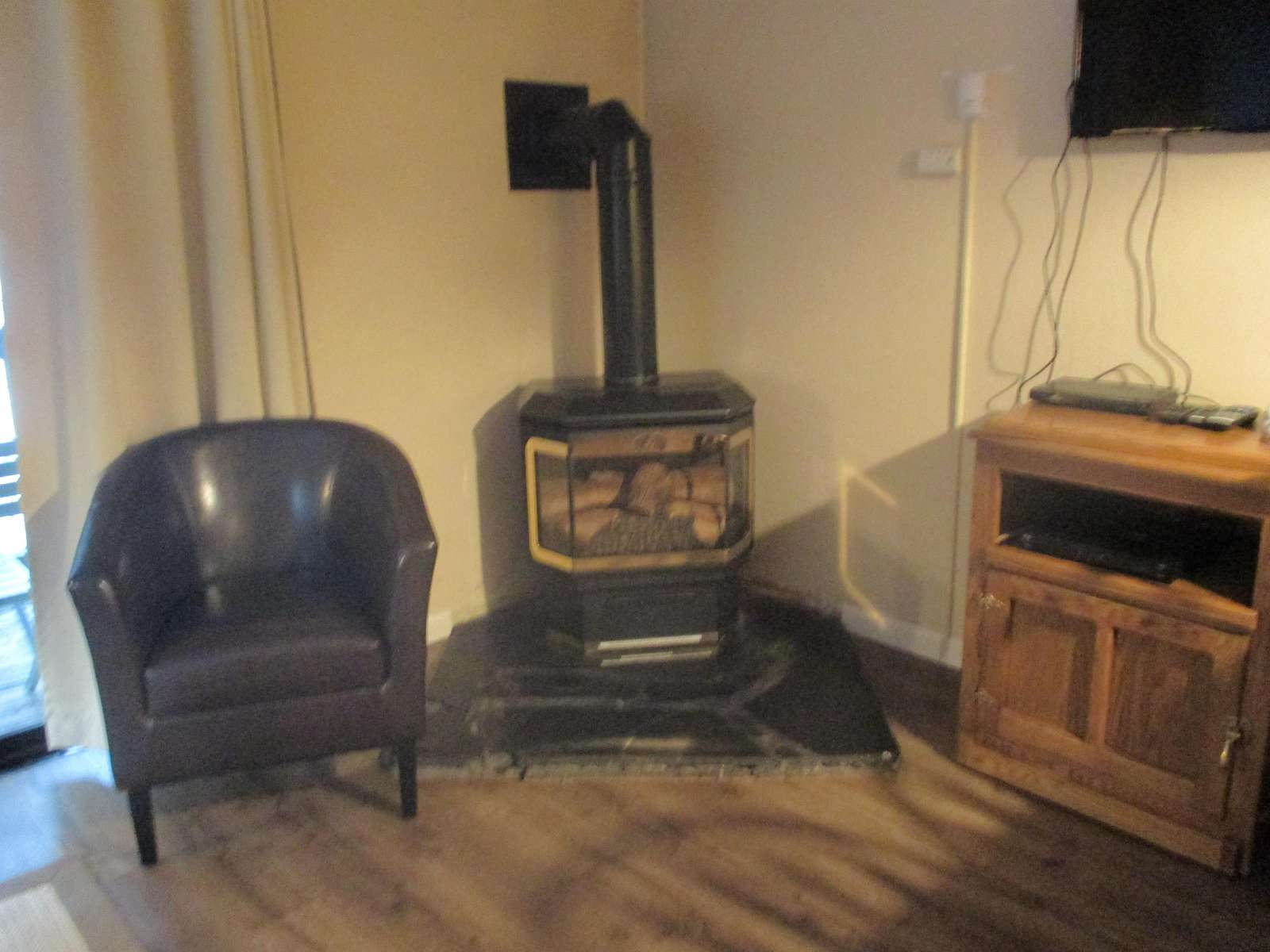 The gas fireplace and satellite plasma TV with DVD player, movies & family games.
