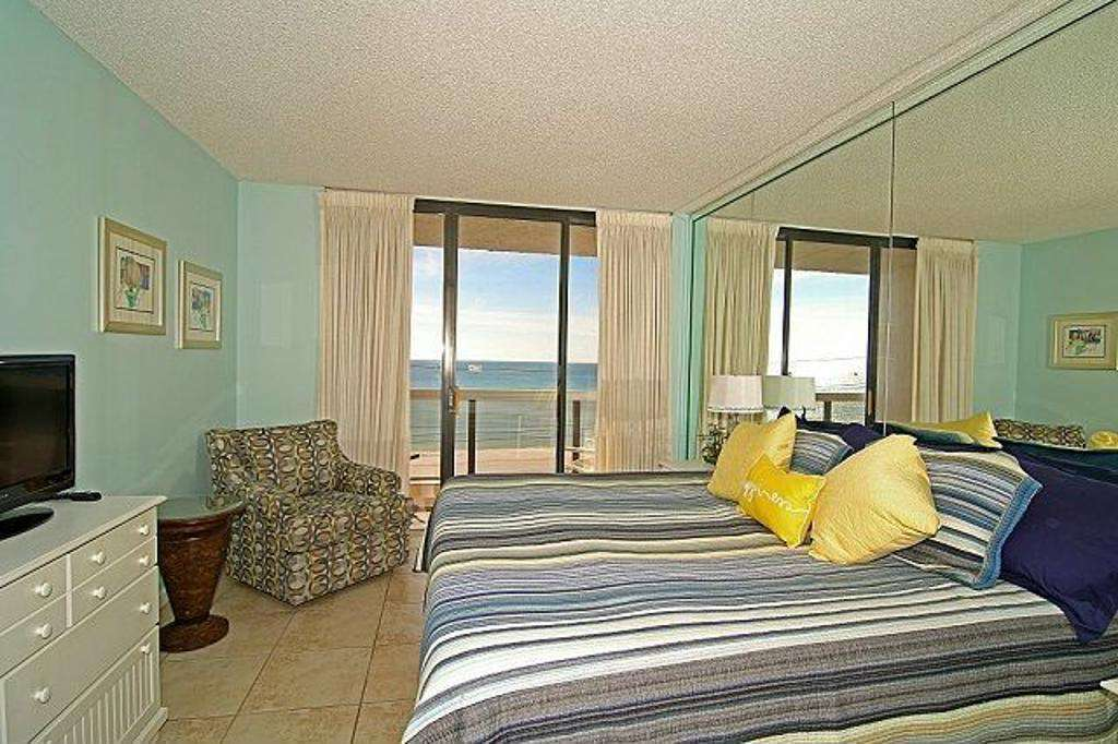 The third bedroom features a king sized bed, private balcony and bath.