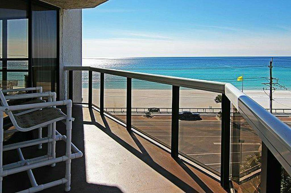 This oceanfront condo features panoramic views of the gorgeous Gulf!