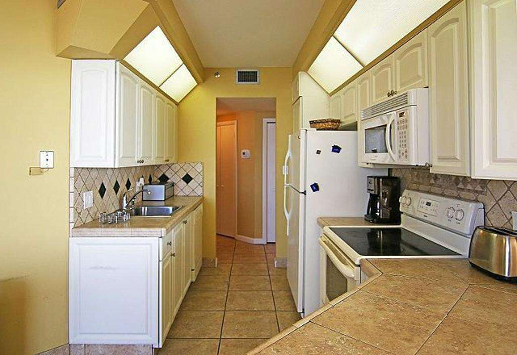 The kitchen opens into the living area.