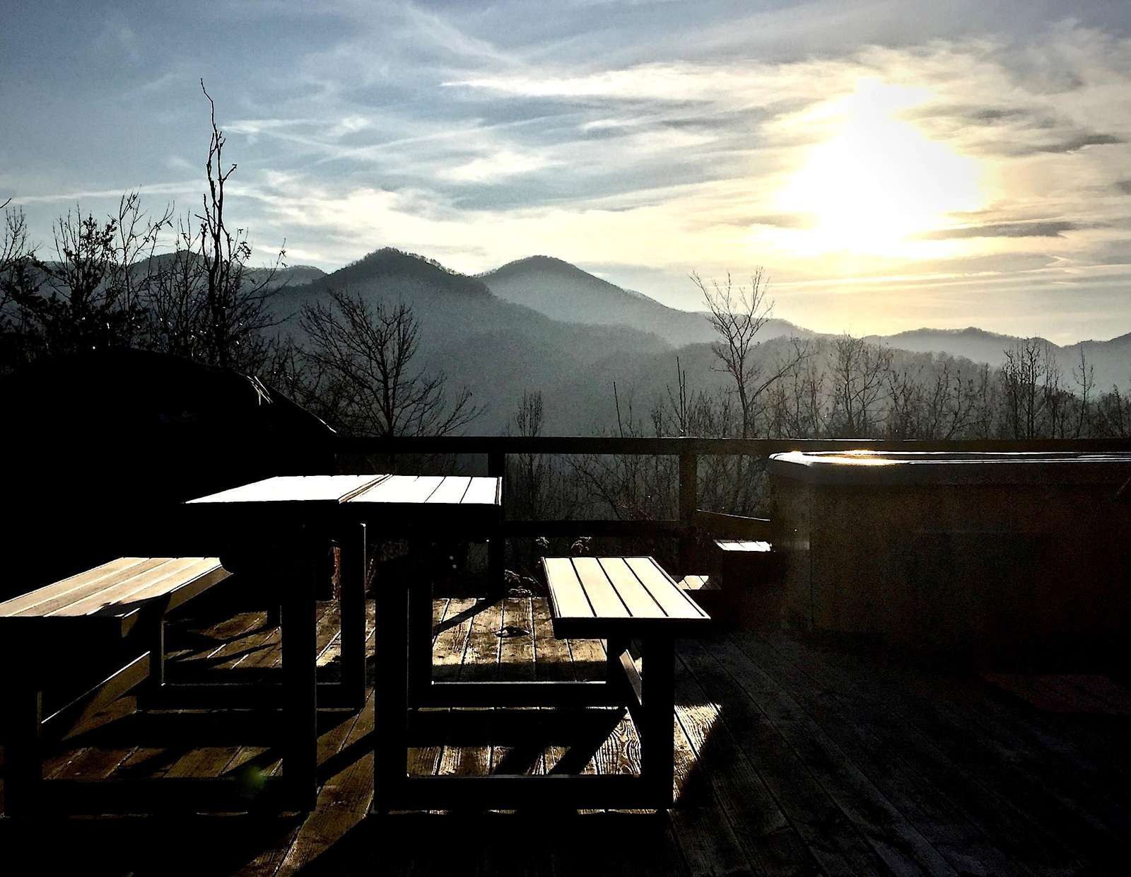 Near the Fire Pit, there is a PicNic Table (converts to Benches)