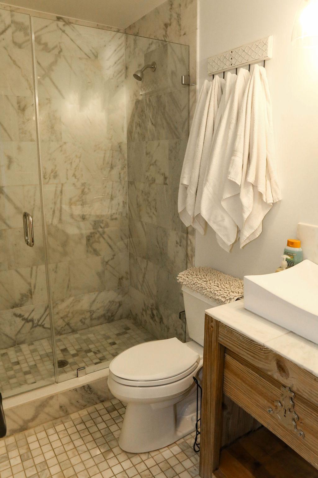 br #4 bath, marble shower with glass door
