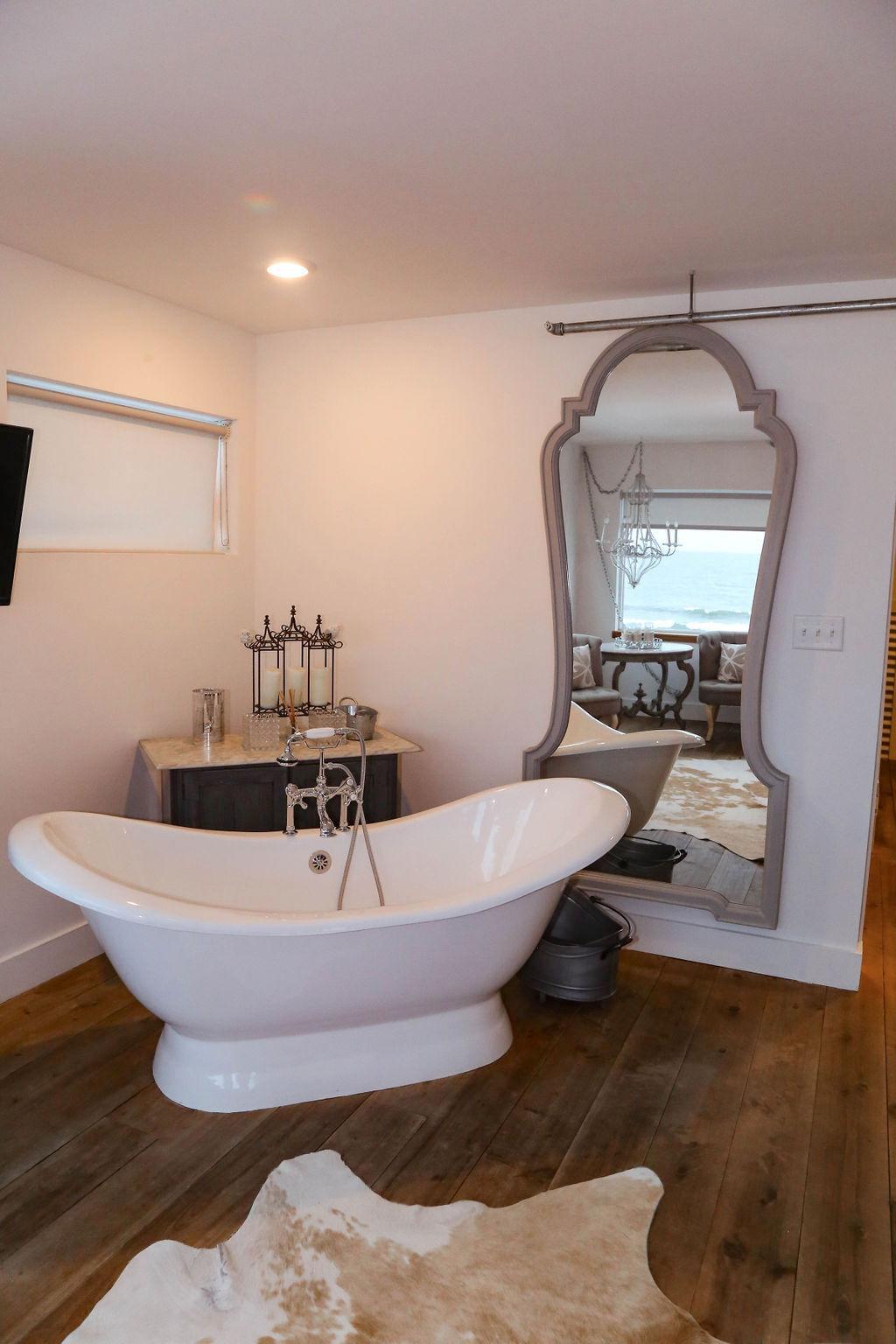 Bedroom # 4  large slipper tub with chandelier --overlooking ocean