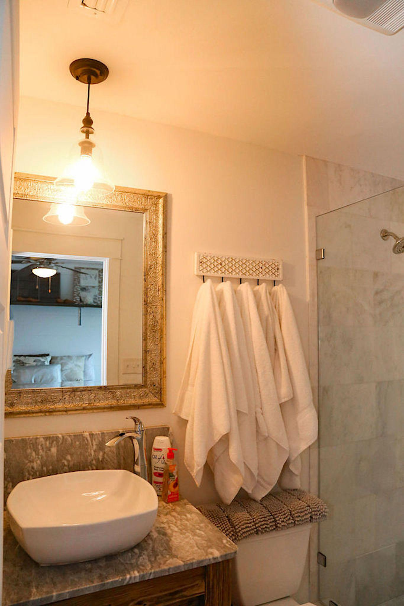 Bathroom # 2 has custom white marble shower