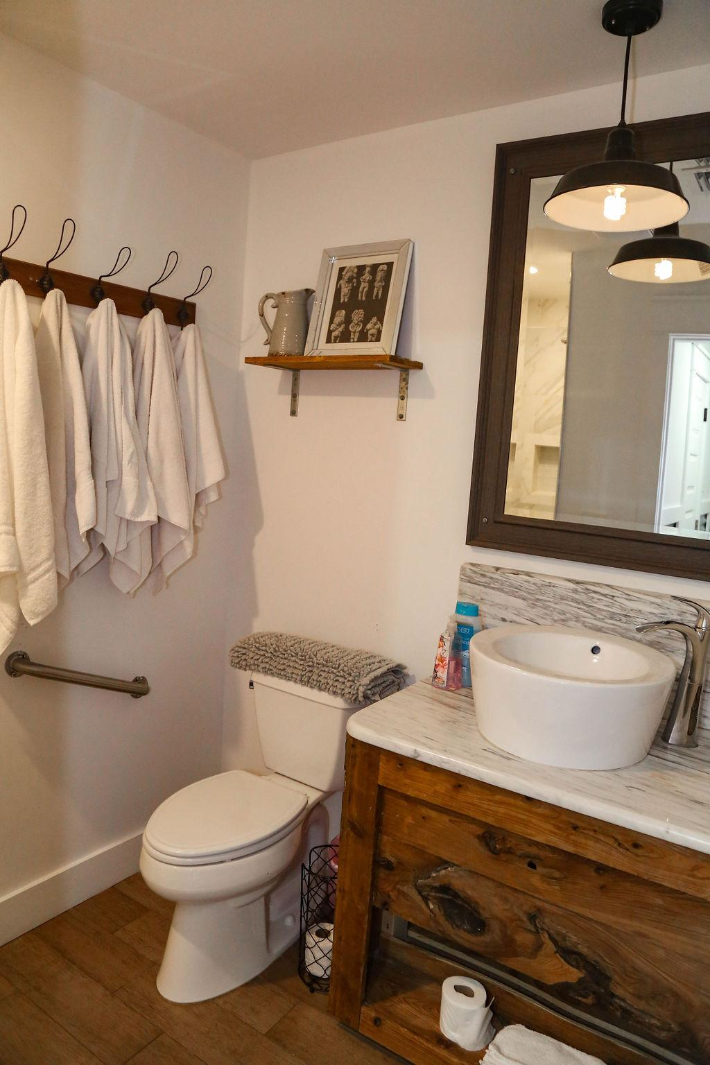 Bathroom #5 has custom white marble shower
