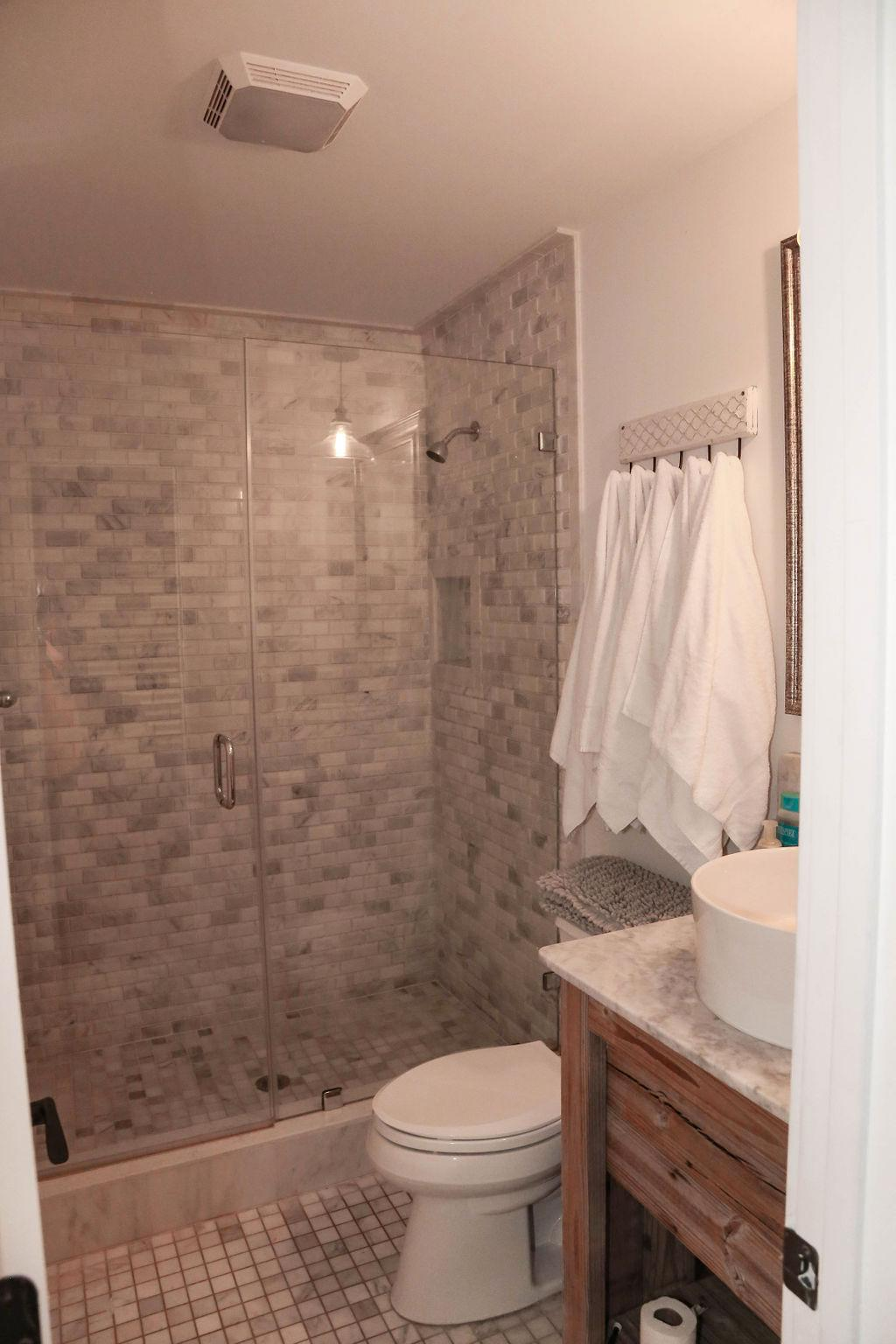 Br # 1 bathroom, white marble shower, glass doors