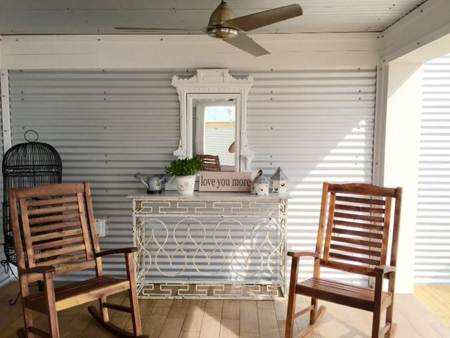 logia with 4 rockers, fans ,sink, overlooking gulf, chairs, tables, umbrella, outdoor showers