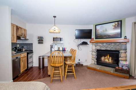 The kitchen and dining area with TV, DVD player and gas fireplace.