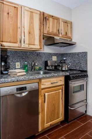 Kitchen has a dishwasher, stove-top oven, microwave, coffee maker and all your cooking needs.