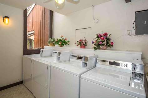 The community laundry room in the condominium building next door.  Detergent is provided, just bring quarters.