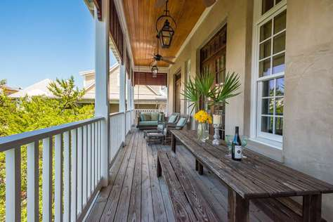 Wrap around balcony with plenty of seating, gas grill and bed swing.
