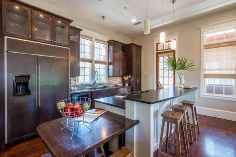 Gourmet Kitchen with Extra Large Refrigerator and Extra Seating Space for 3 at Small Table at End of Island