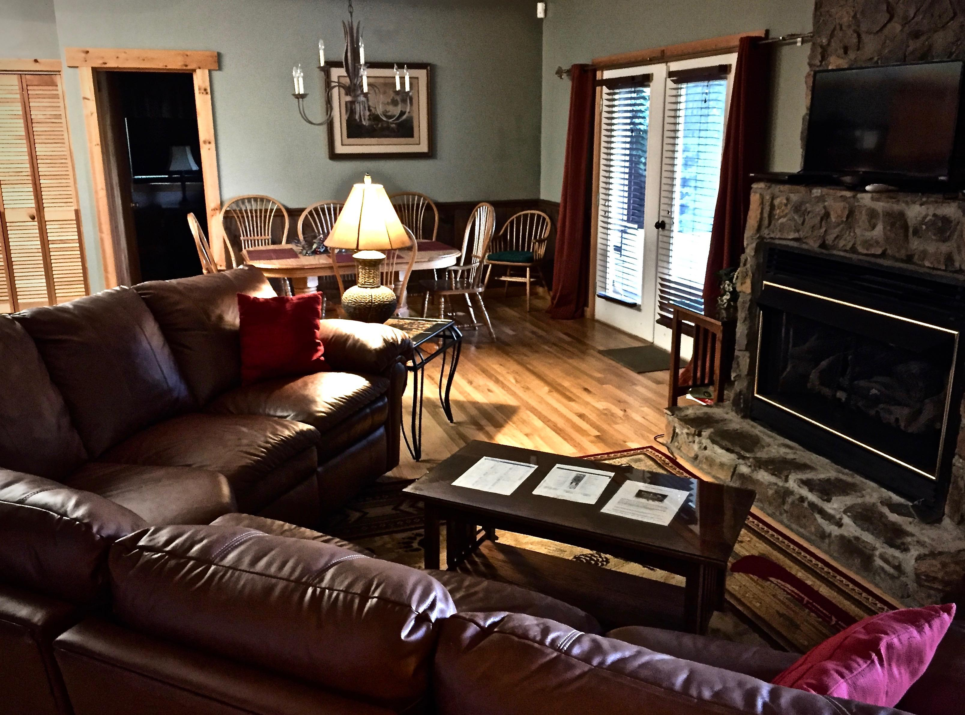 Open Floor Plan with french doors flanking each side of the Stone Fireplace complete the Living/Great Room