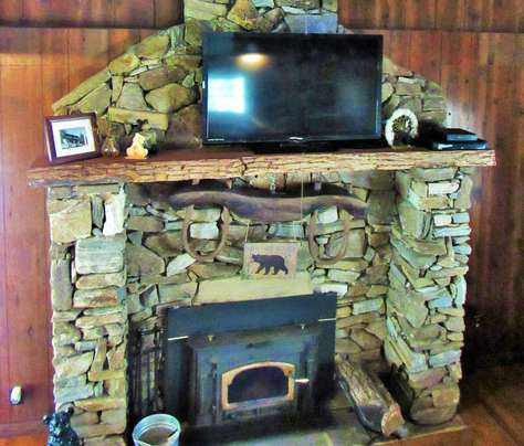 Massive Native Stone Fireplace with Wood Stove Inset