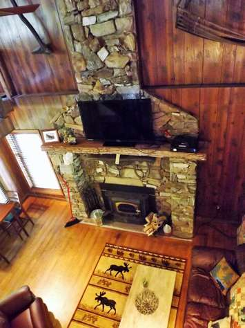 Native Stone Fireplace is reminiscent of days gone by...