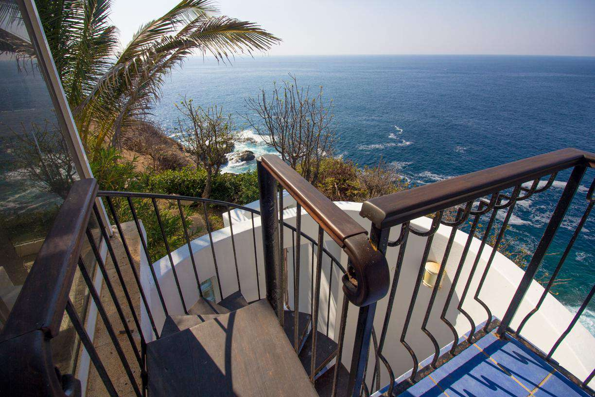 Private stairwell to 2nd master suite and pool/bbq area