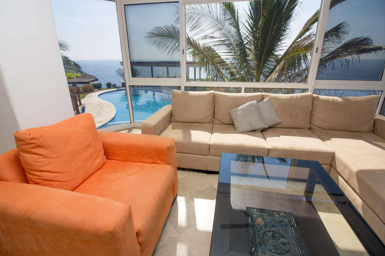 View of ocean and pool area from living room