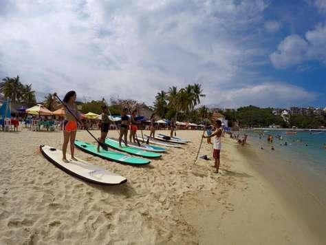 Take a surf or paddle board lesson in Santa Cruz