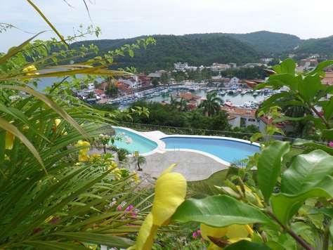 Just steps away to 2 pools overlooking Santa Cruz bay and marina