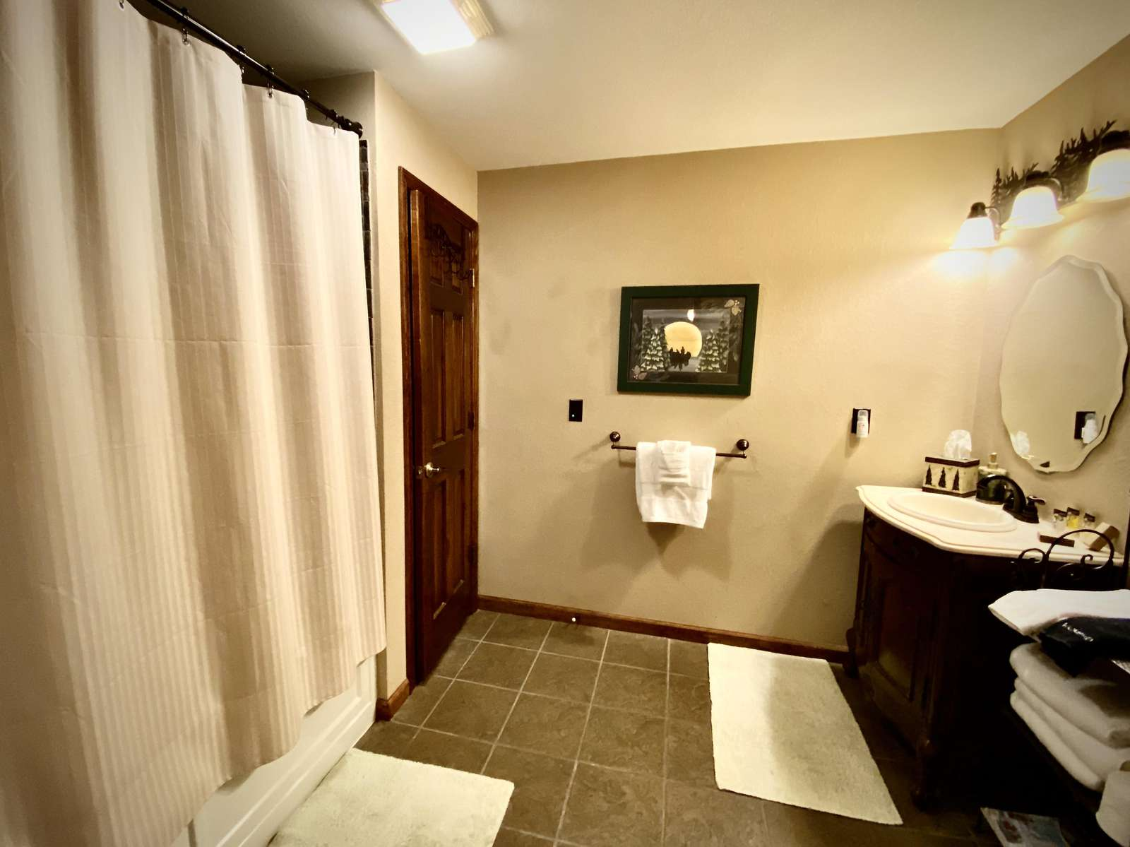 One of 3 Full Bathrooms (Master Bathroom offers a Jetted Tub)