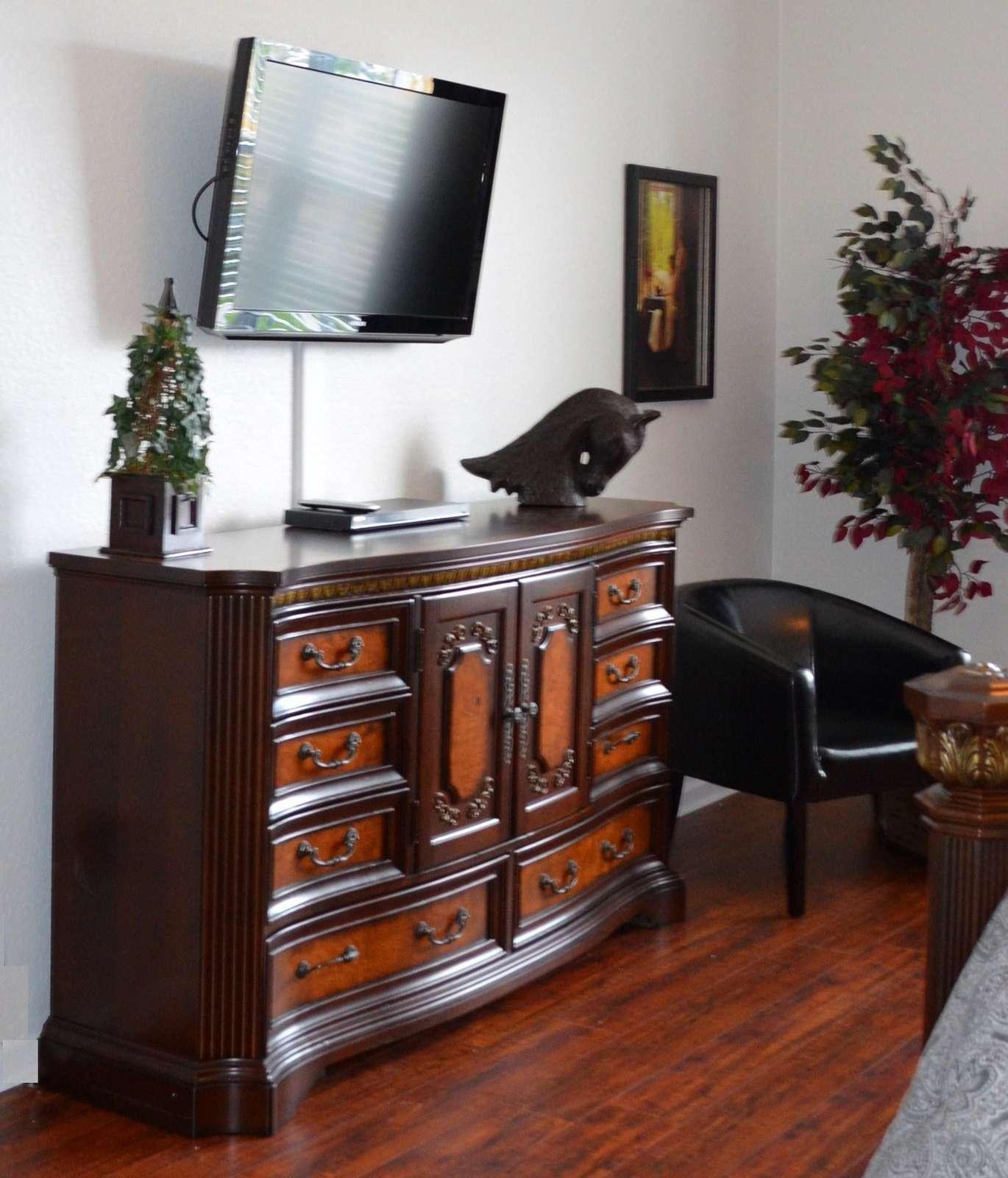 Flat-screen TV in master bedroom