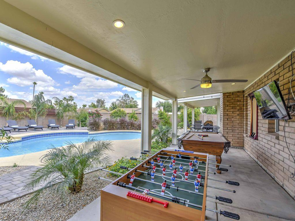 covered decks with foosball and a pool table-TV