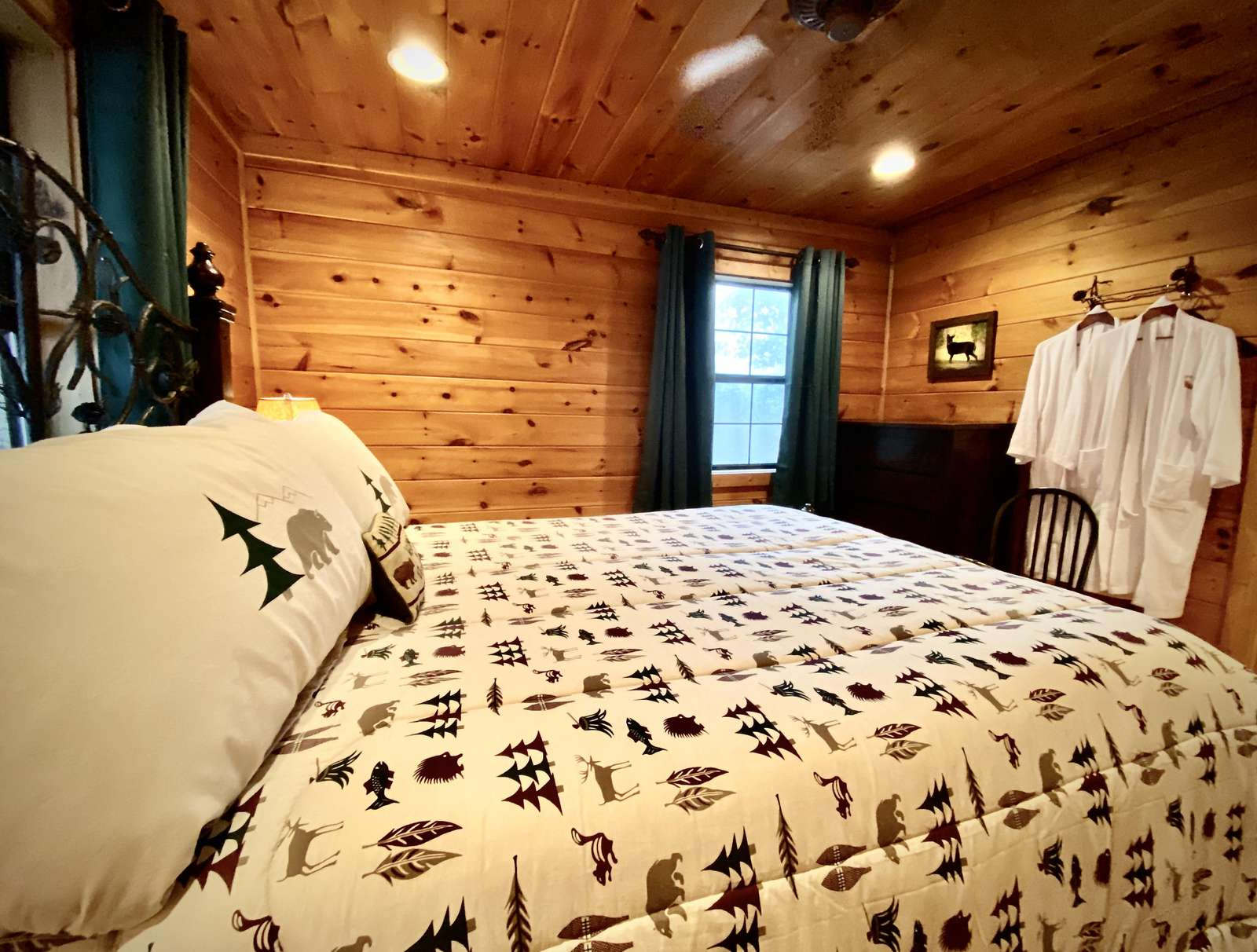 Comfortable Queen Bed and Plush Bathrobes await...
