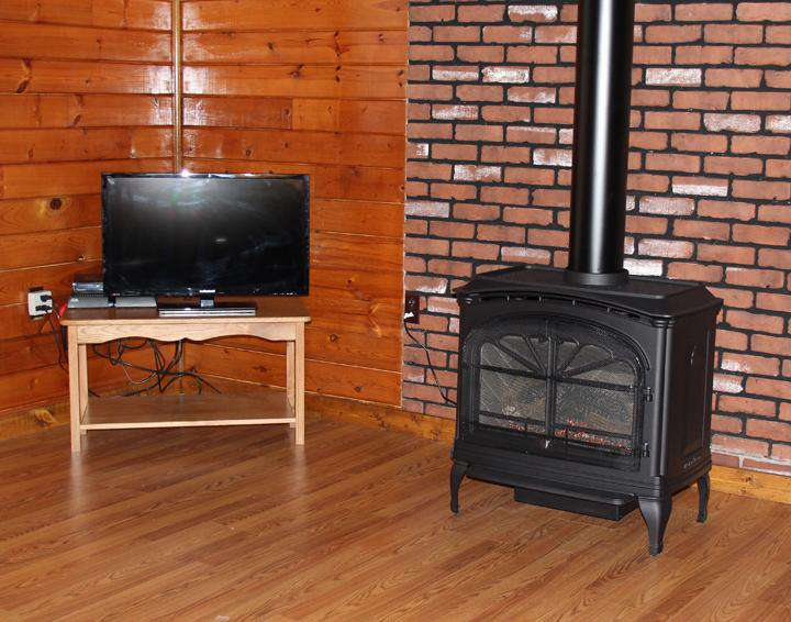 Living Room showing Gas Stove & TV