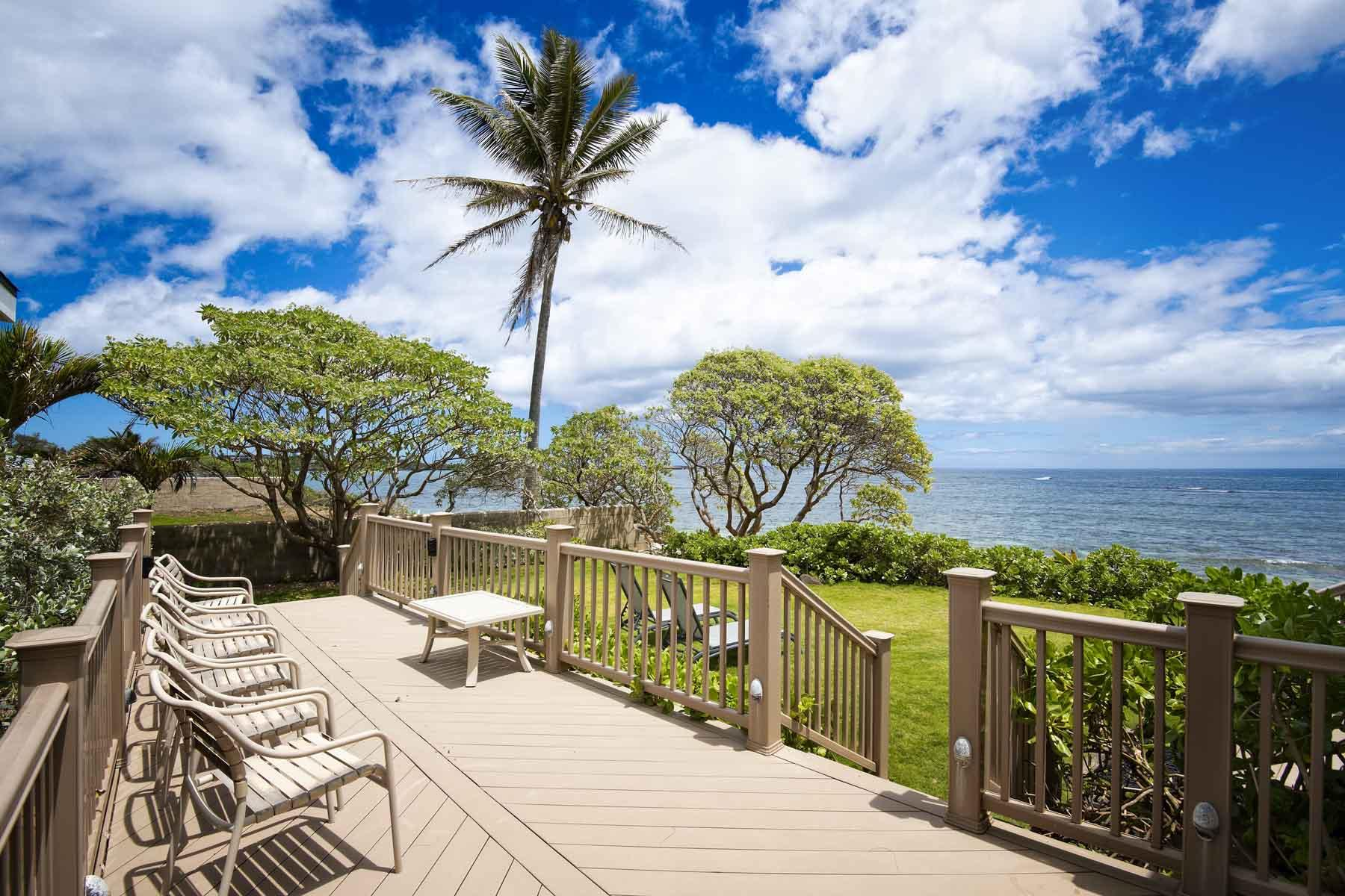 Private deck with on beachfront .