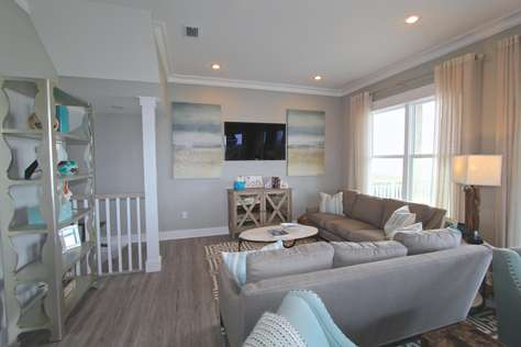 Gulf front family room with deck access