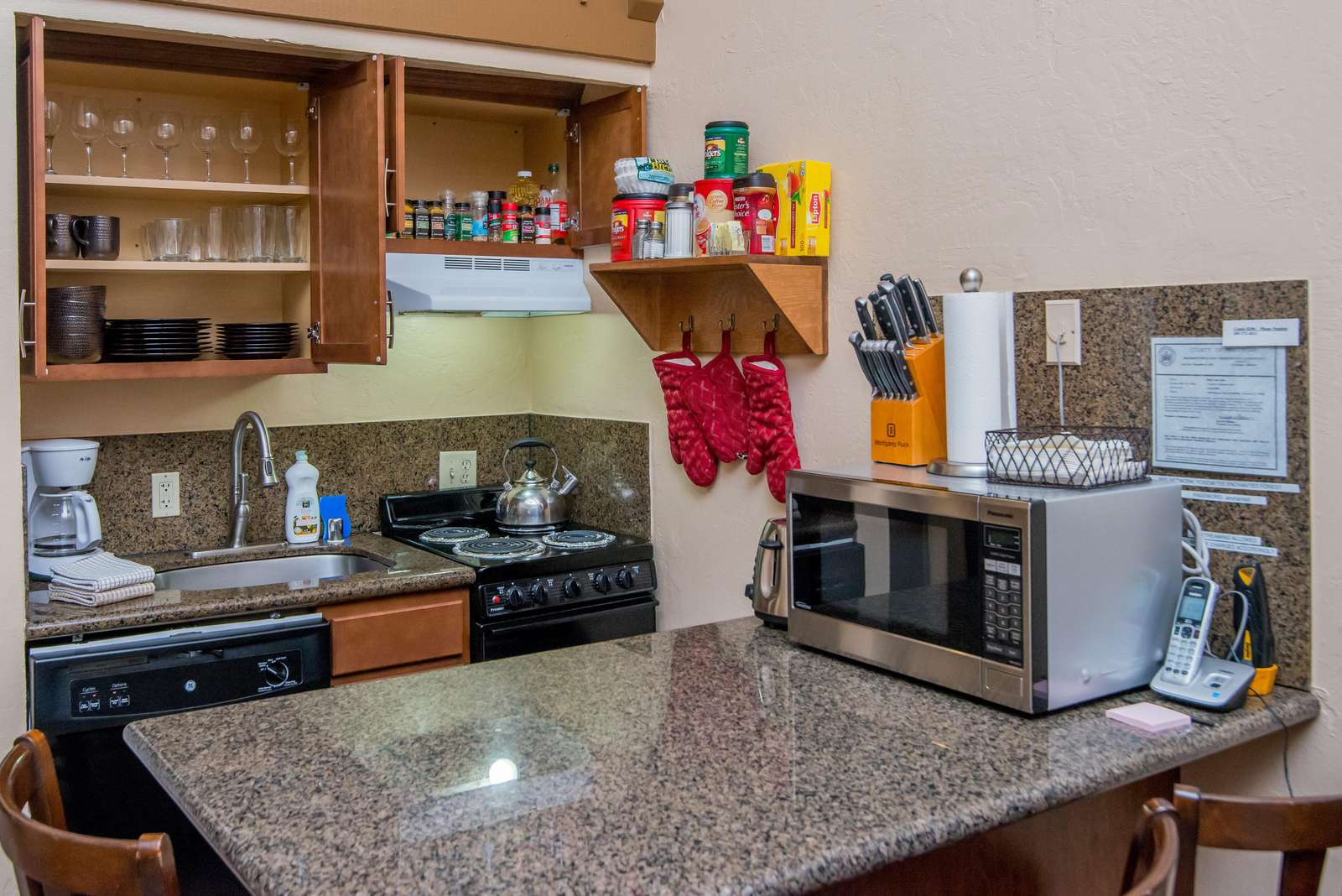 Cupboards are stocked with dishes and glasses.  Spices, coffees, cooking oil, utensils and plenty of other kitchen amenities provided for your comfort.