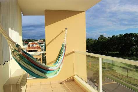 Balcony with hammock overlooking the beach