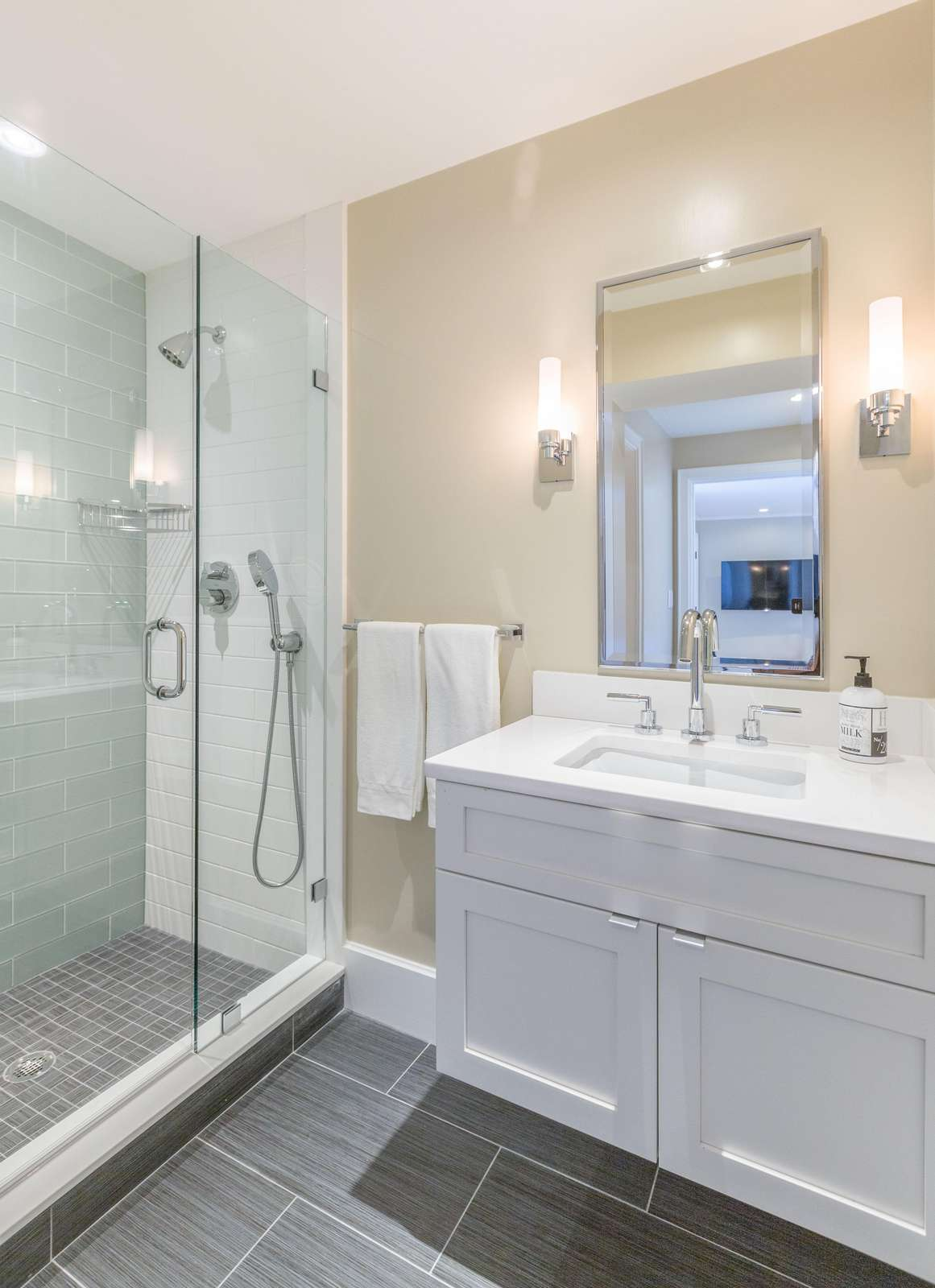 Full bathroom with gorgeous tile shower, glass doors and 2 shower heads