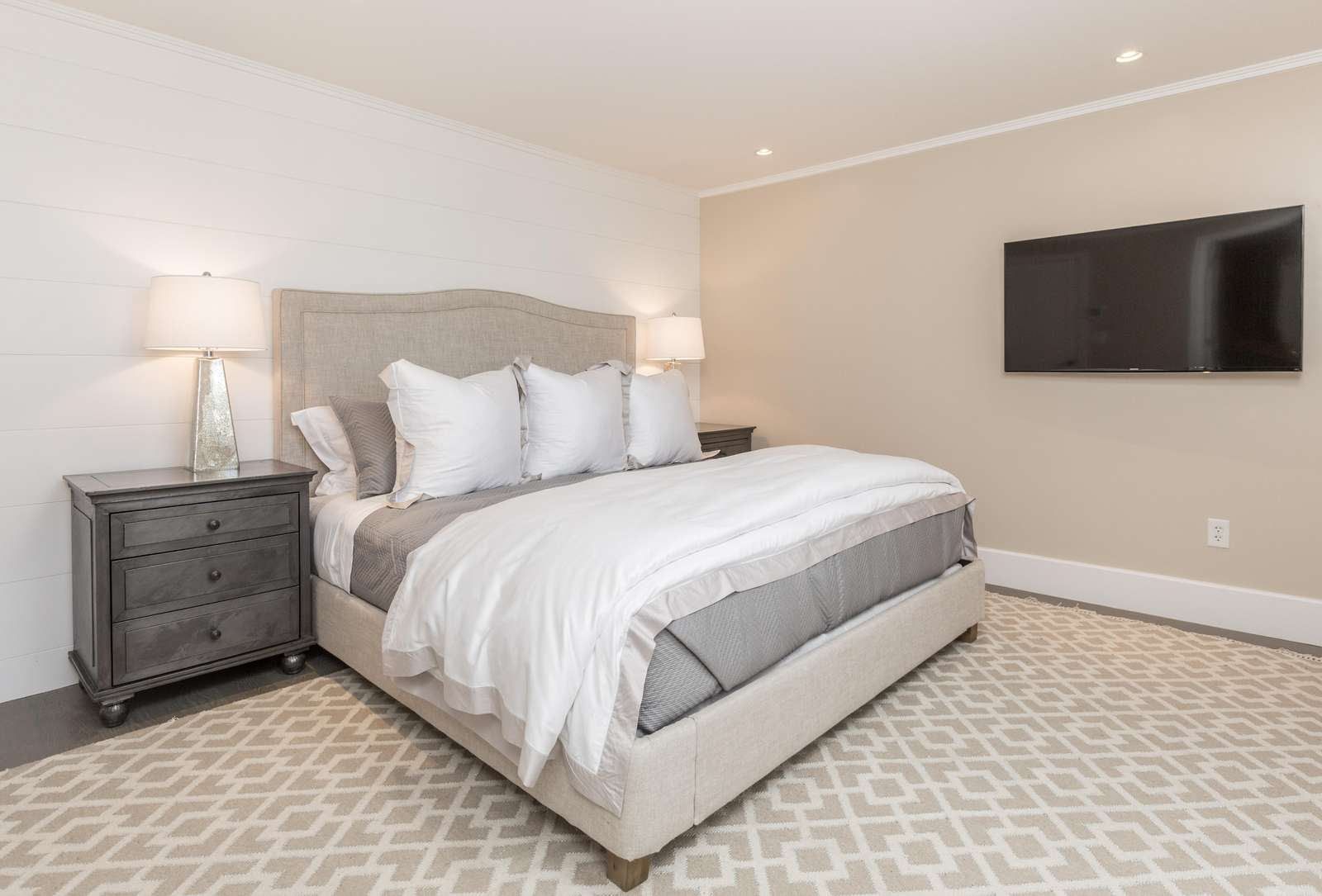 Spacious bedroom with kind size bed and LED TV
