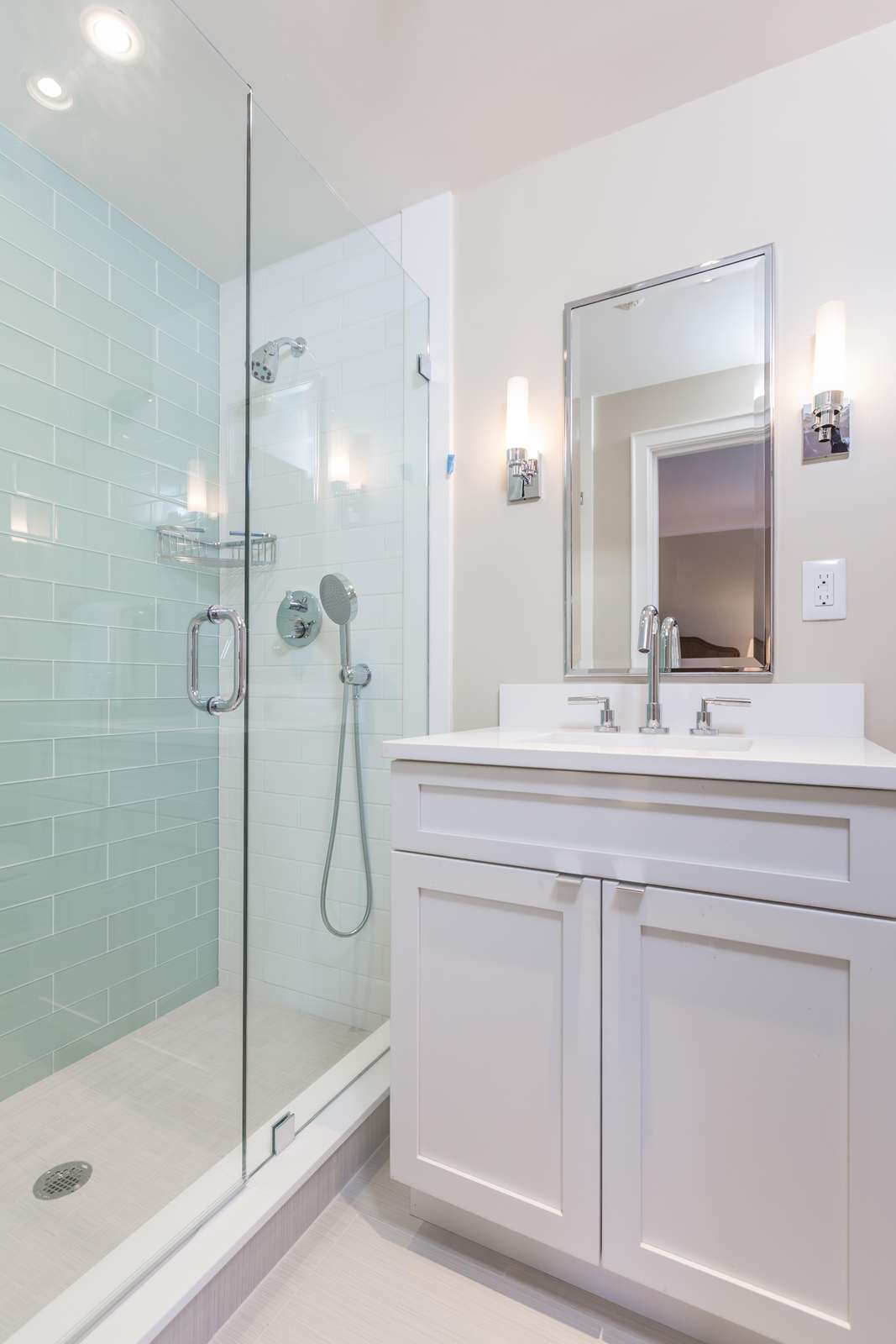 2nd bathroom with tile shower, glass doors and 2 shower heads