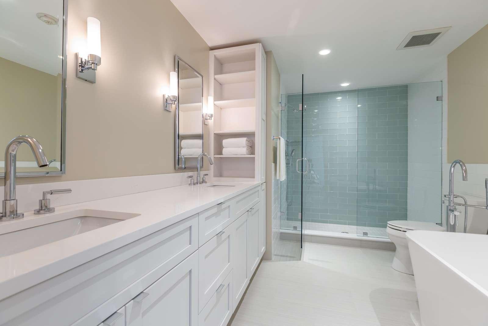 Master bathroom with double vanity, bath tub, elegant tile shower
