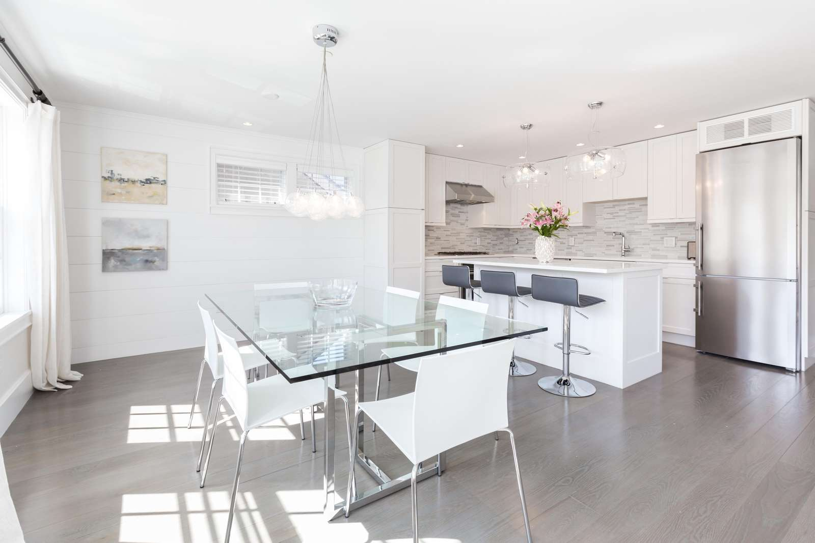 Fully equipped kitchen.  Elegant glass dining room table, seats 6