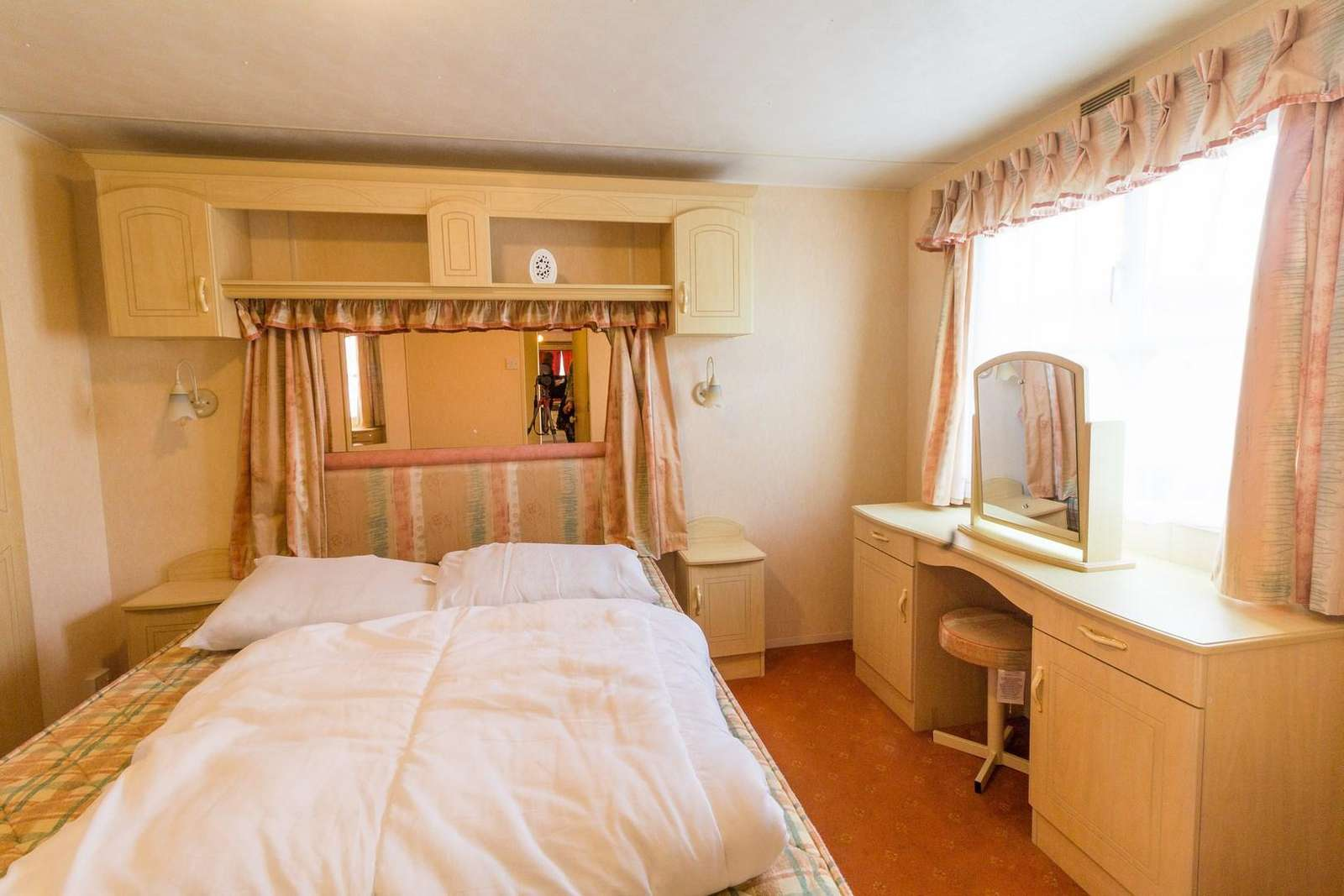 Master bedroom with dressing area in this 6 berth caravan for rent just minutes from the beach in Hunstanton.