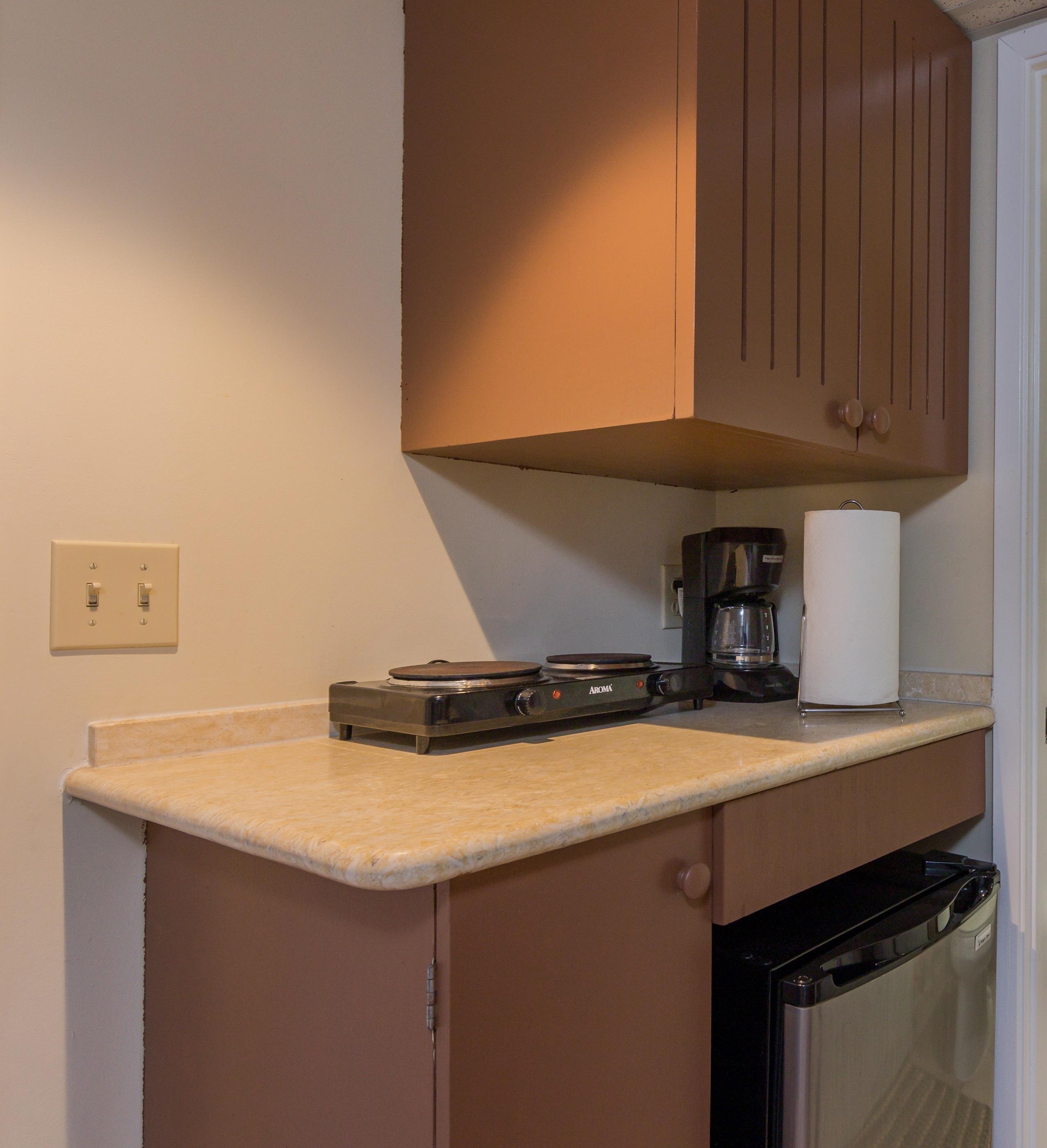 In-Room Conveniences mini fridge, coffee maker and electric burners