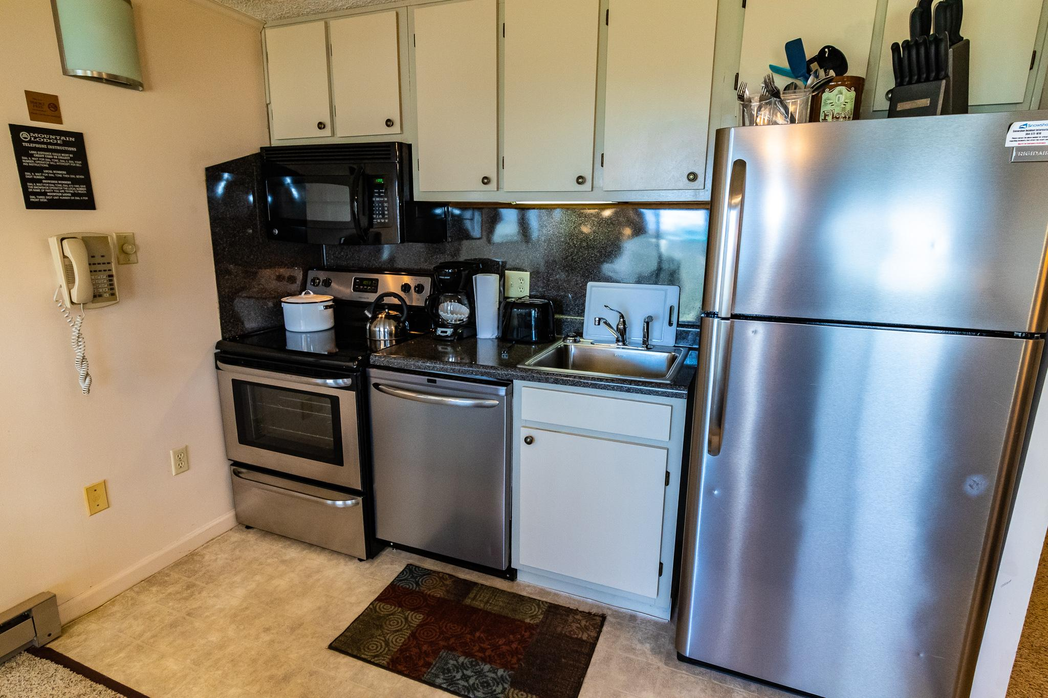 Fully-equipped kitchen with stainless steel appliance, pots, pans, utensils!
